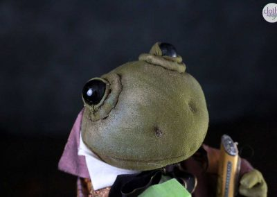 courting frog doll face detail