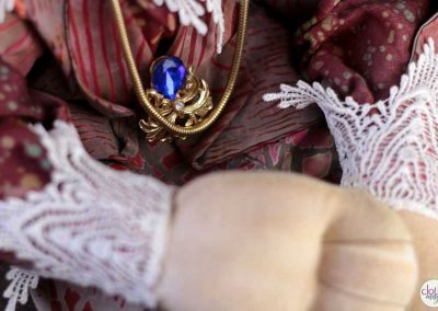 leopold the lion doll - cloth magic jewelry detail